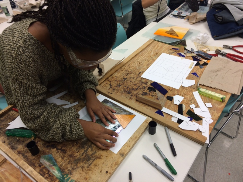 Classmate piecing project during workshop at GaTech's Paper and Clay Studio.
